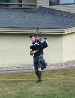 A piper must perform in all weather conditions! It was a windy day competing at Loon Mountain in NH!